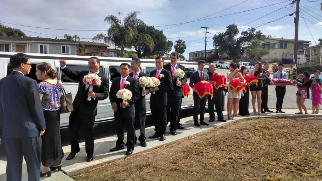 large viet american family prepares for a wedding with a plus limos