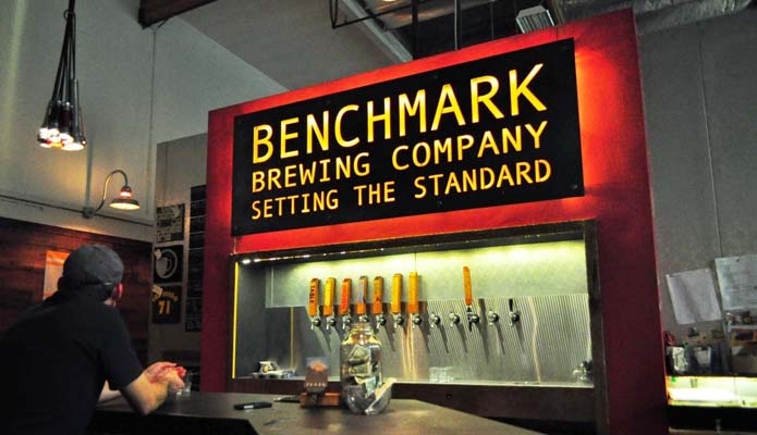 man at benchmark brewing tasting room