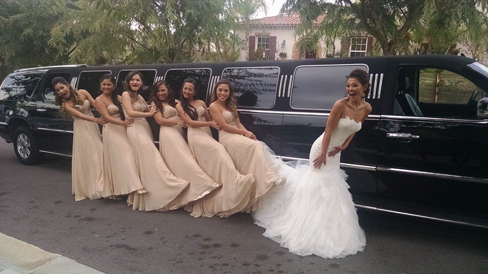 Bride and six bride's maids having fun before wedding
