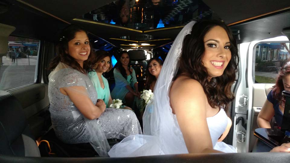 bride in white gown with her attendants