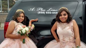 twin sisters with limousine on their 15th birthdays