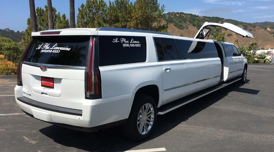 white cadillac escalade limousine